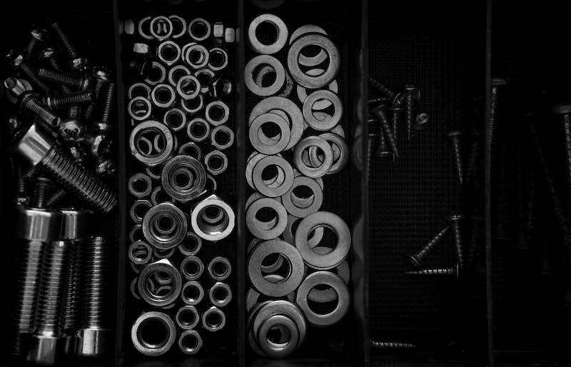 nuts and bolts arranged in a tray